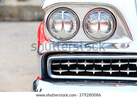 Retro styled image of a front head lamp classic car - stock photo