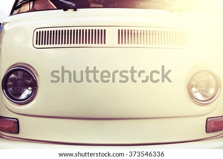 Retro styled image of a front of a classic car. - stock photo
