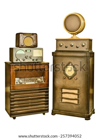 Retro styled image of a set of vintage radio's isolated on a white background - stock photo