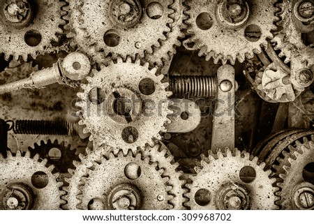 Retro styled image of the innerworks of an old machine with cogs and gears