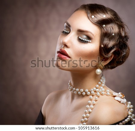 Retro Styled Makeup With Pearls. Beautiful Young Woman Portrait - stock photo