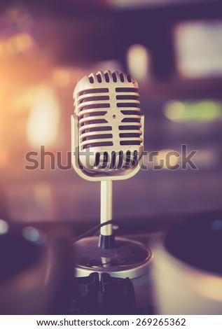 Retro styled microphone,vintage color toned image - stock photo