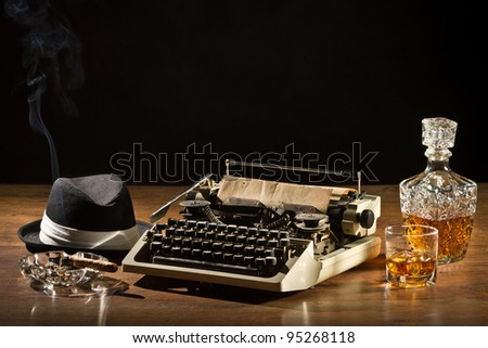 Retro-Styled old typewriter, cigar, hat and whisky with carafe - stock photo
