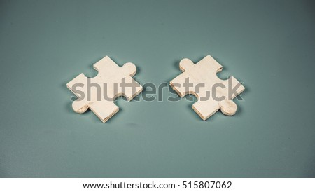 Retro styled or retro color pieces of blank wooden puzzle. Concept of classic game. Slightly de-focused and close-up shot. Copy space.