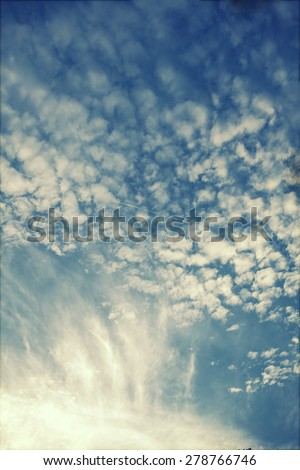 Retro styled photo of beautyful blue sky and clouds - stock photo