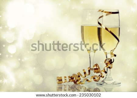 Retro styled photo of glasses with champagne on sparkling background - stock photo