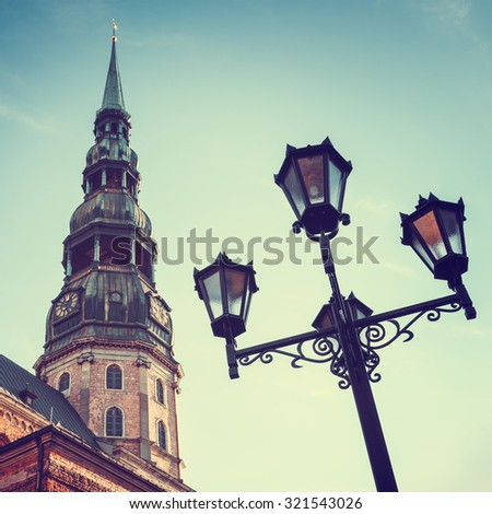 Retro styled photo of St Peters Church in old city Riga, Latvia. - stock photo
