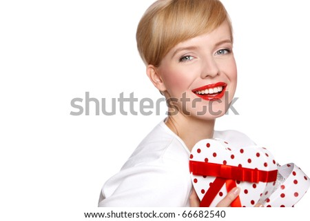 Retro styled portrait of pin-up blond woman with gift, isolated on white - stock photo