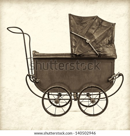 Retro styled sepia image of a vintage baby stroller - stock photo