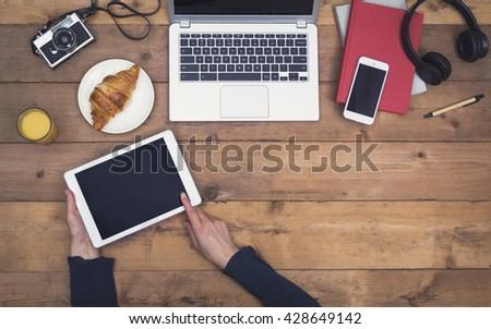 Retro styled tablet and smartphone responsive design hero header - stock photo