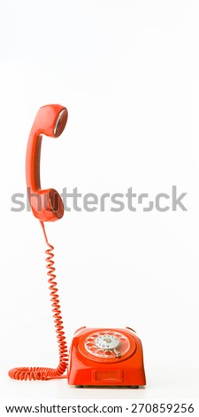 retro styled telephone with receiver standing up, isolated on white background - stock photo