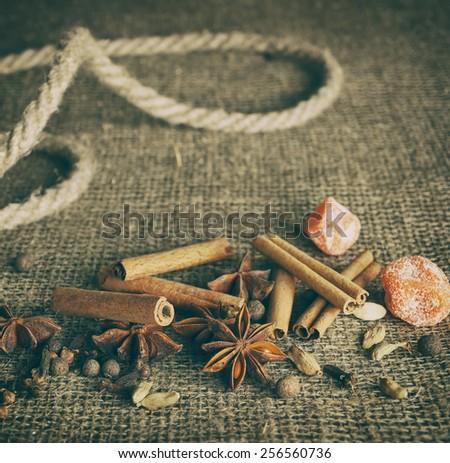 Retro Stylized Image Of Spices On The Burlap - stock photo