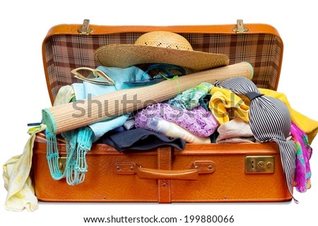 Retro suitcase, full of clothes and vacation items, isolated on white background. - stock photo