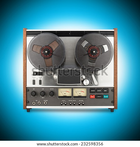 retro tape recorder in front of blue background - stock photo