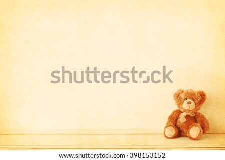 Retro Teddy Bear toy alone on wooden background. Vintage - stock photo