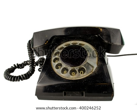 Retro telephone on table in front mint green background / old phone in front of a dark background  / Phone / Old black Rotary Telephone handset / old phone on white background