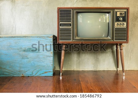 Retro television with blue wood container in the old room - stock photo