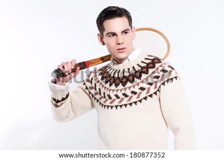 Retro tennis fashion man holding a vintage wooden racket. Studio shot against white. - stock photo