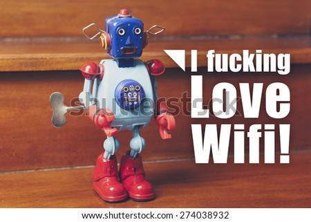 """Retro tin robot, with text """"I Fucking Love Wifi"""". - stock photo"""