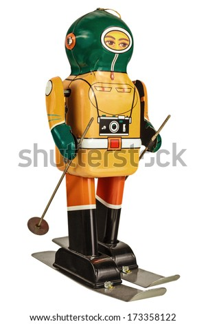 Retro tin wind up robot skier isolated on a white background - stock photo