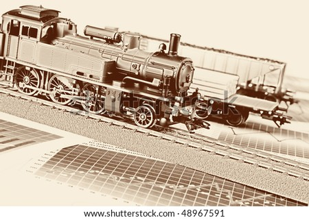 Retro train on graphs background - stock photo