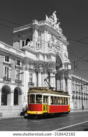 retro tram on the streets of Lisbon - stock photo