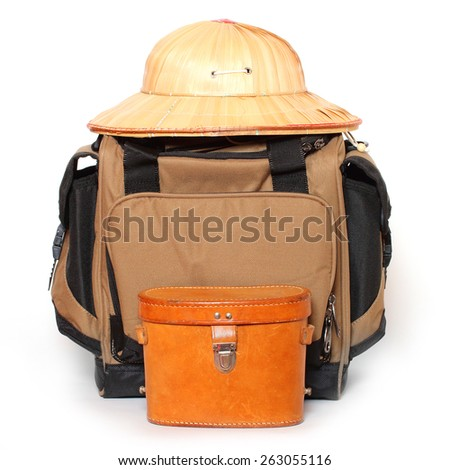 Retro travel bag and tropical hat. - stock photo