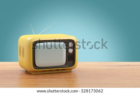 retro tv in seventies style isolated on a table - stock photo