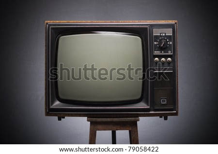 Retro TV on a dark background. - stock photo