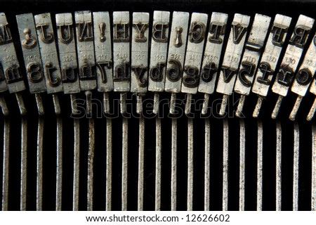 retro typewriter macro shoot on keys - stock photo