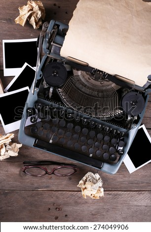 Retro typewriter on wooden table, top view - stock photo