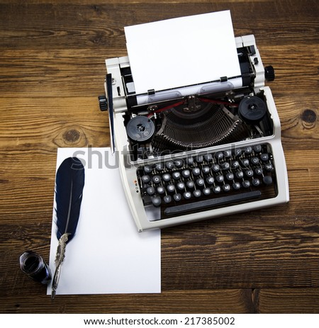 Retro typewriter with white paper  - stock photo