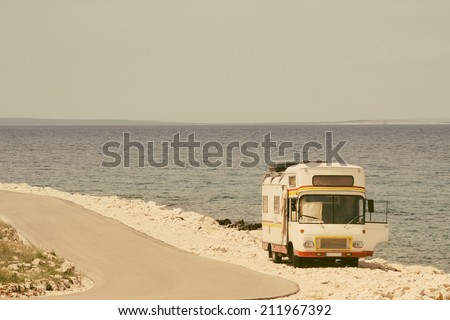 Retro van by the sea on the old vintage photo filter - stock photo