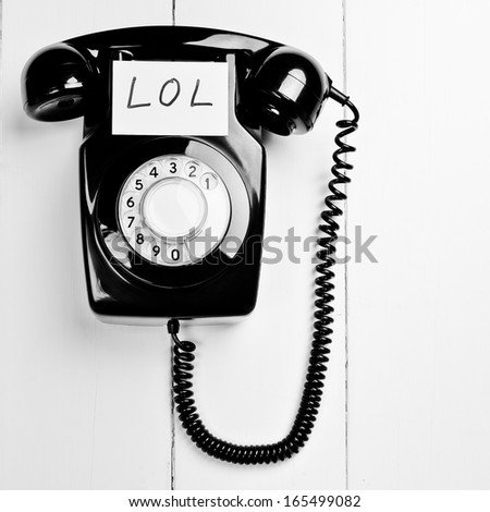 Retro versus modern telephone concept - stock photo