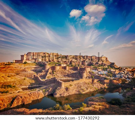 Retro vintage hipster style image of Mehrangarh Fort and Padamsar Talab and Ranisar Talab lakes on sunset , Jodhpur, Rajasthan, India.