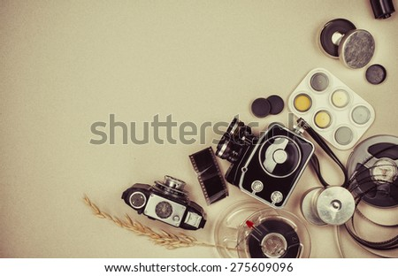 Retro vintage movie camera  and photo camera with copyspace - stock photo