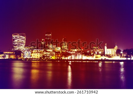 RETRO/VINTAGE PHOTO FILTER EFFECT:City of London at Night,one of the leading centers of global finance.This view includes Tower 42 Gherkin,Stock Exchange Tower and Lloyd`s of London and Walkie Talkie.