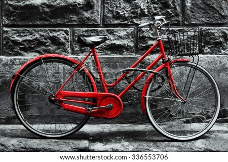 Retro vintage red bike on black and white wall. Old charming bicycle concept. - stock photo