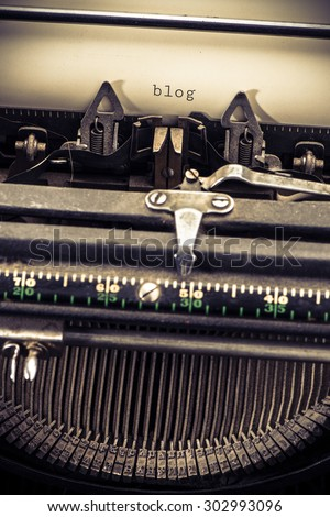 Retro vintage typewriter and the text blog. Conceptual image of old fashioned office work, communication or writing. - stock photo