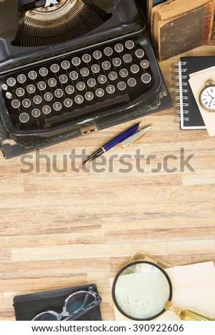 retro ????? vintage typewriter on working table with copy space, top view - stock photo