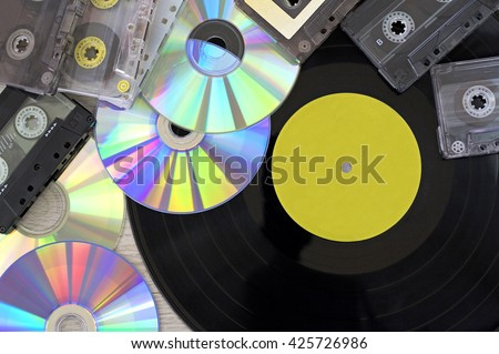 Retro, vinyl record disc, audio cassette and cd - stock photo