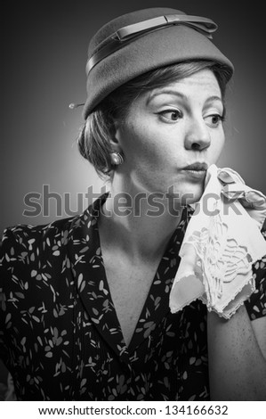 Retro woman dabbing her mouth with a handkerchief