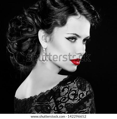Retro woman. Fashion model girl portrait. Black and white photo. Isolated on black background. - stock photo