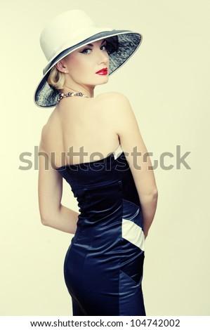 Retro woman in hat - stock photo