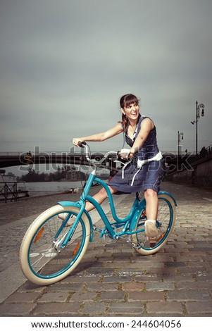 Retro woman on retro bike - stock photo