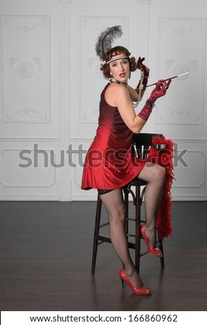 Retro Woman Portrait. Beautiful Woman on a bar stool - stock photo