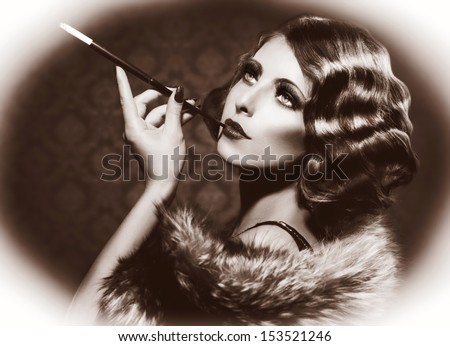 Retro Woman Portrait. Beautiful Woman with Mouthpiece. Cigarette. Smoking Lady. Vintage Styled Black and White Photo. Old Fashioned Makeup and Finger Wave Hairstyle. 20's or 30's style. Sepia toned - stock photo