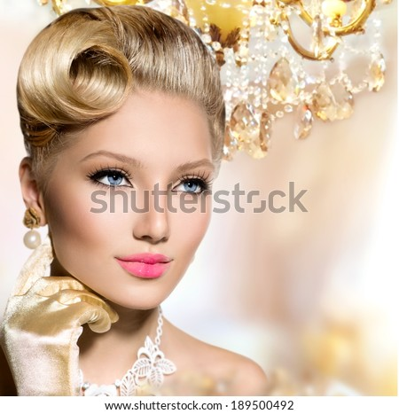 Retro Woman Portrait. Glamour Lady. Beauty Vintage styled Girl with perfect make up and hairstyle. Luxury interior - stock photo