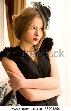Retro woman portrait in classic interior