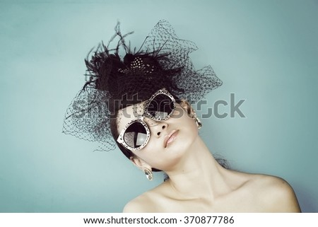 Retro Woman Portrait. Vintage Style Girl Wearing Old fashioned Hat, Beautiful black hat with feathers. Romantic Beauty, Retro Style. (Vintage Style Color) - stock photo